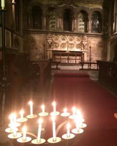 St Thomas, candles burning